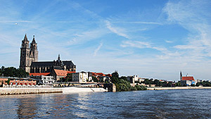 Cathedral of Magdeburg and the river Elbe. Courtesy: Torsten Maue - Flickr: Blick zum Dom. Licensed under CC BY-SA 2.0 via Wikimedia Commons